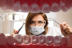 female-dentist-dental-tools-view-young-patient-s-mouth-37191408